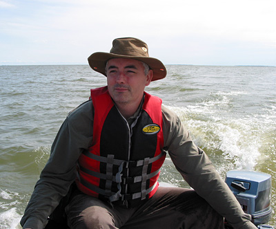 Sean Robson pilots the Museum's zodiac on the broad waters of Lake Winnipeg's north basin.