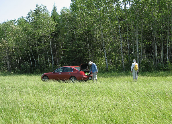 Bob and I unload gear at the edge of the field. (photo by Ed Dobrzanski)