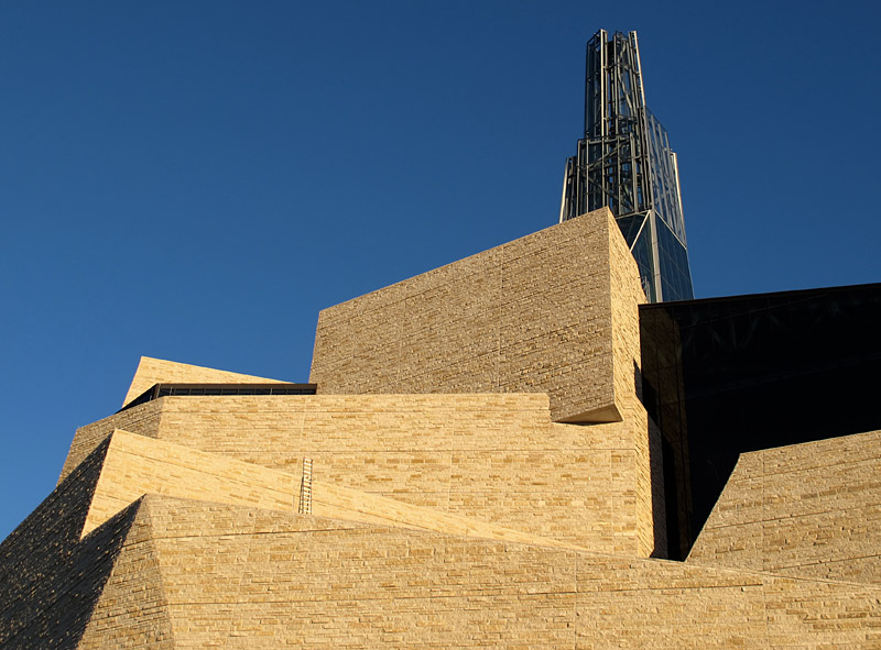 On the building's exterior, Tyndall Stone walls appear as a stack of irregular polygons.