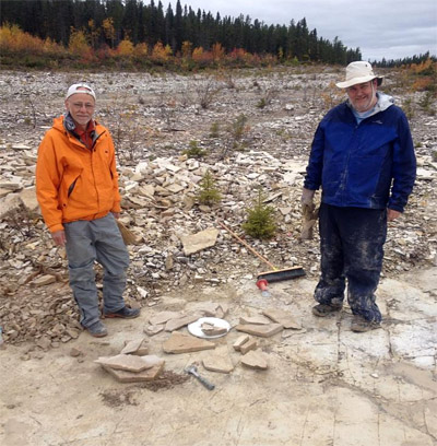Dave and Michael stand by the cluster of eurypterid-bearing slabs