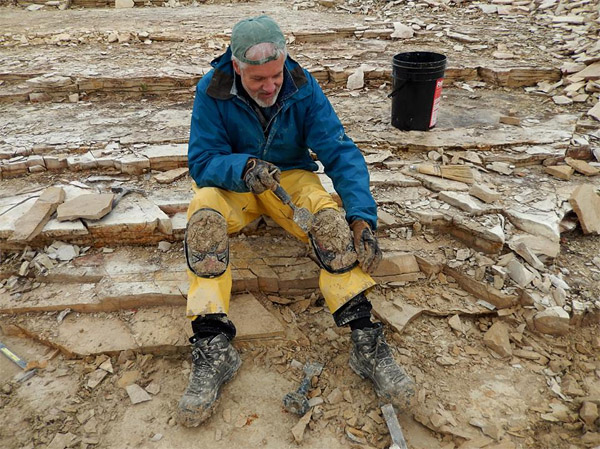 Scraping away the inch of mud adhered to my kneepads