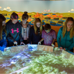 group of kids working together on Lake Winnipeg: Shared Solutions exhibit