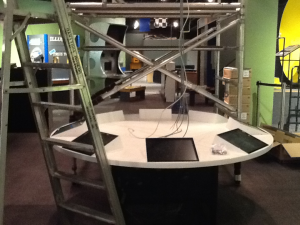 Installing the Lake Winnipeg Shared Solutions simulator table in the Science Gallery.