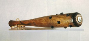 """While aeroplanes and artillery shells flew through the sky, trench warfare could be as simple and brutal as hand-to-hand combat. This oak """"trench club"""", fitted with hobnails and weighted with a lead core, was used against the enemy once trenches were overrun. H10-1-84. Copyright The Manitoba Museum."""