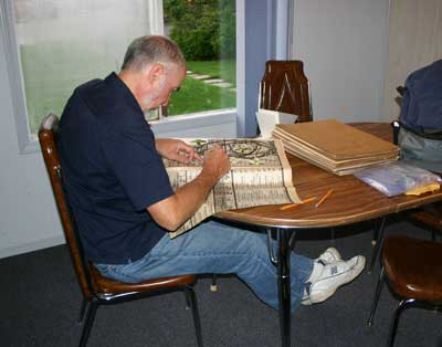 John Wiersema pressing scientific specimens.  These specimens will be cared for at The Manitoba Museum.