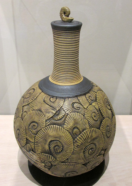 This ammonoid urn, inspired by Cretaceous fossils, was created by Kevin Conlin.
