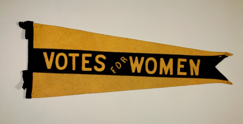 Felt pennant, circa 1910-1916. Black and yellow were the colours of the Suffragist movement in North America. Donated by Warren West. H9-38-198. Copyright The Manitoba Museum.