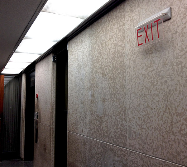 The hallway near the elevators may look like an unprepossessing remnant of the 1960s, but ...
