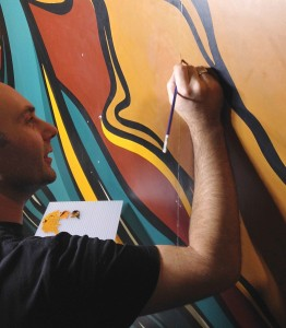 Conservator Radovan Radulovic works on large crack in mural
