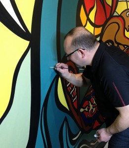 Yatsewych tests out the colour he created on the mural