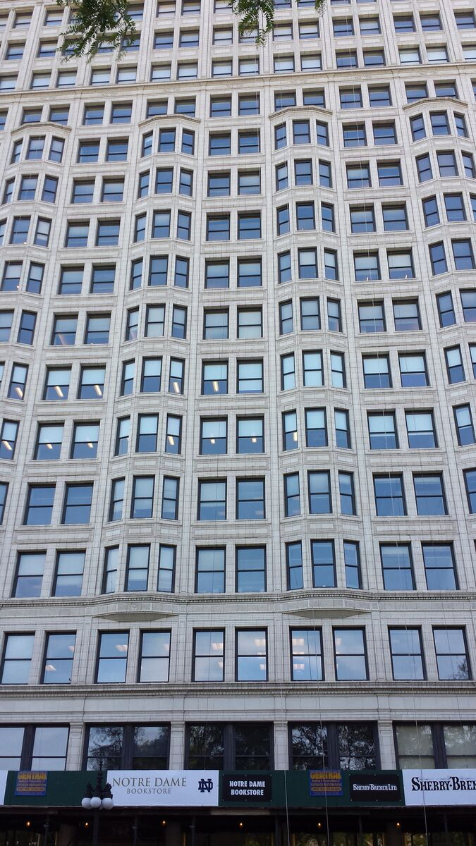 Terracotta was a fired clay sheathing used to fireproof the building. It was available in a gleaming white, as in the Burnham and Co. Sante Fe building in Chicago (1904).