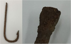 Is there the outline of a maker mark on this fishhook? We won't know for sure until after conservation.