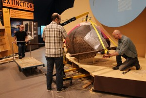 Before Sean can begin to hoist the replica, Bert adjusts the attachments.