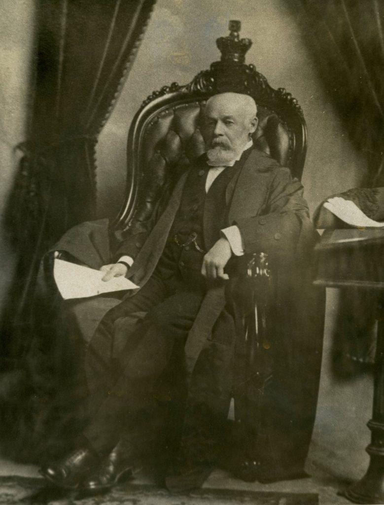 William Hespeler seated in the Speaker's Chair, ca. 1903. Courtesy Jeremy Hespeler-Boultbee.