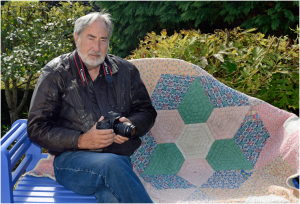 "Anthony Craddock has been a professional photographer since 1965 and is now a director of Images Etc Ltd"" Anthony Craddock with quilt, 2016 © Anthony Craddock"