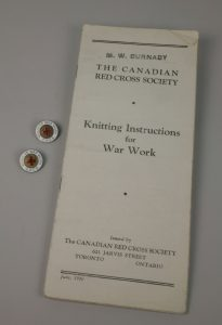 Lapel pins, H9-22-407 and H9-31-994, Knitting Pattern, H9-29-545 © The Manitoba Museum