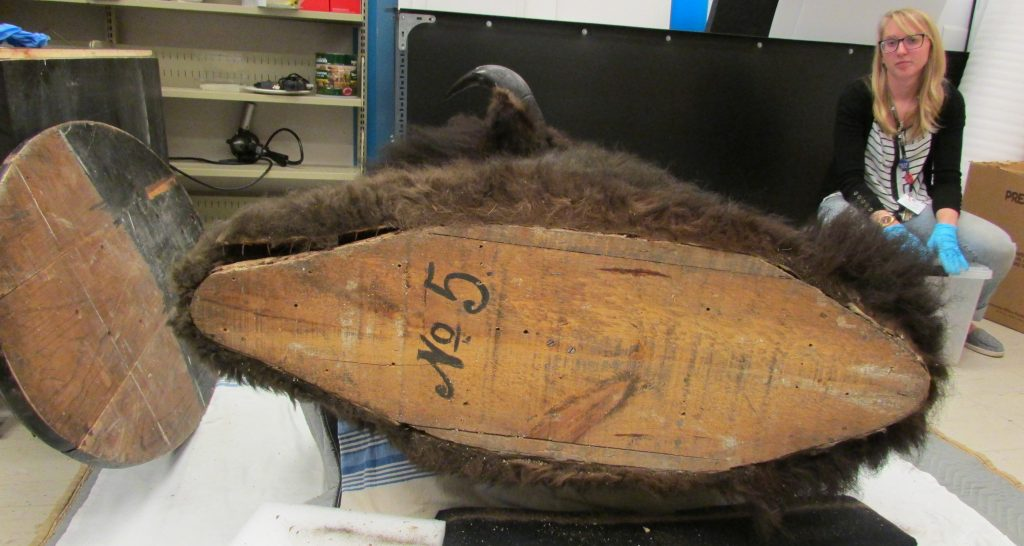 Conservator Carolyn Sirett discovered the #5 under the backboard while fixing the mount for exhibit.