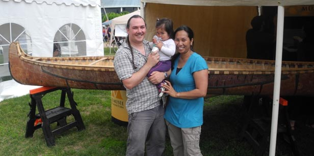 Kevin, Myra and Meghan at The Manitoba Museum tent with canoe