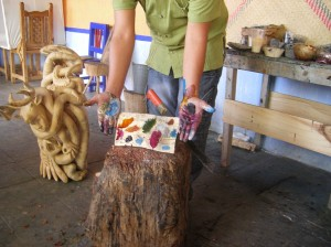 A variety of natural dyes are used to paint the wood carvings