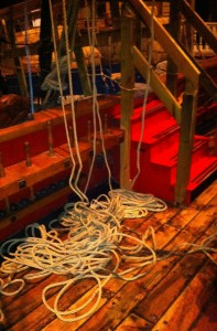 We've thrown the lines off the belaying pins and they're lying loose on deck