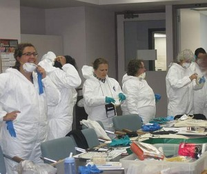 Participants wear protective clothing. In an emergency scenario, there could be dust, mould and water