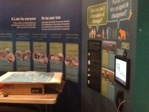 """Installing the """"Champion of Change"""" panels, where people learn what they can do to help save Lake Winnipeg."""
