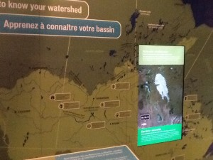 Satellite images of Lake Winnipeg are overlaid on a giant map of the watershed.